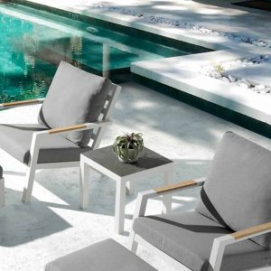 Brus corner table by pool
