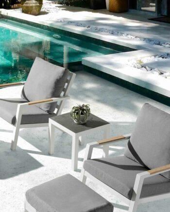 Brus corner table by pool
